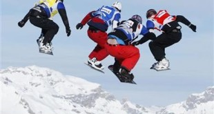 (L-R) David Speiser of Germany, Nick Baumgartner of the U.S., Francois Boivin of Canada and Pierre Vaultier of France are airborne during the final of the men's FIS World Cup snowboard cross event in Veysonnaz January 15, 2010.  REUTERS/Denis Balibouse