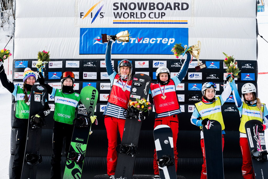 FIS Snowboard World Cup - Moscow RUS - Team SBX - Women's podium with 2nd Canada 3(BERGERMANN Zoe and CRITCHLOW Tess) in Green, 1st France 1(MOENNE LOCCOZ Nelly and TRESPEUCH Chloe) in Red and 3rd Switzerland 2(CASANOVA Lara and MEILER Simona) in Yellow © Miha Matavz/FIS