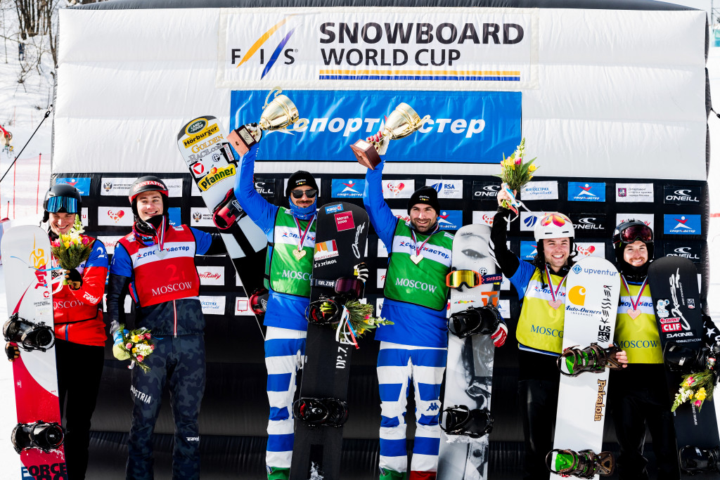 FIS Snowboard World Cup - Moscow RUS - Team SBX - Men's podium with 2nd Austria 4(HAEMMERLE A. and LUEFTNER Julian) in Red, 1st Italy 1(PERATHONER Emanuel and VISINTIN Omar) in Green and 3rd United States 6(LEITH Senna and VEDDER Jake) in Yellow © Miha Matavz/FIS