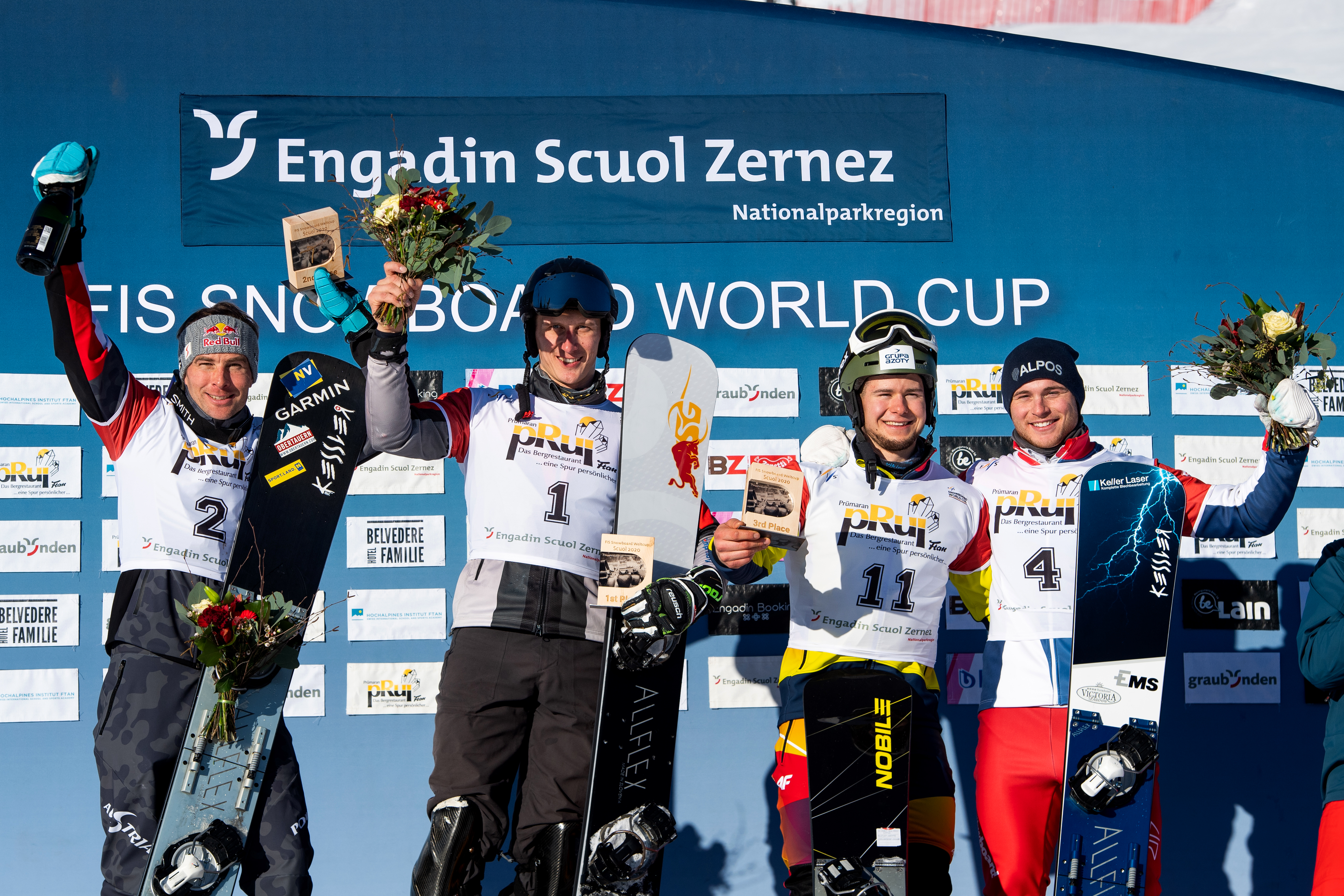 FIS Snowboard World Cup - Scuol SUI - PGS - Men's podium with 2nd KARL Benjamin AUT, 1st SOBOLEV Andrey RUS, 3rd KWIATKOWSKI Oskar POL and CAVIEZEL Dario SUI © Miha Matavz/FIS